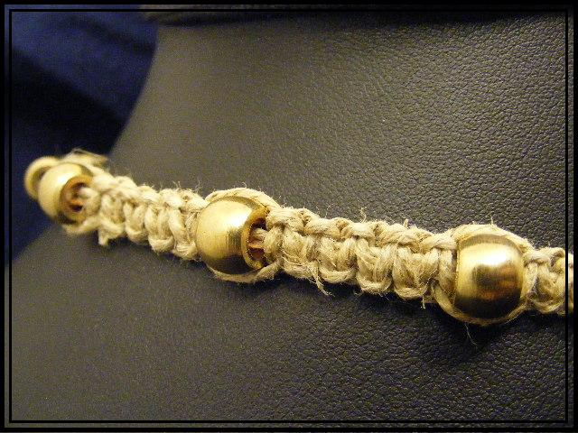 gold metal bead on hemp