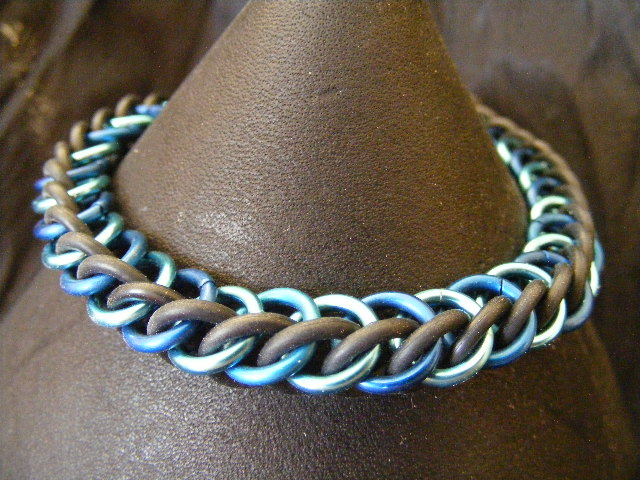 HP3-1 in shades of blue with black stretchy bracelet