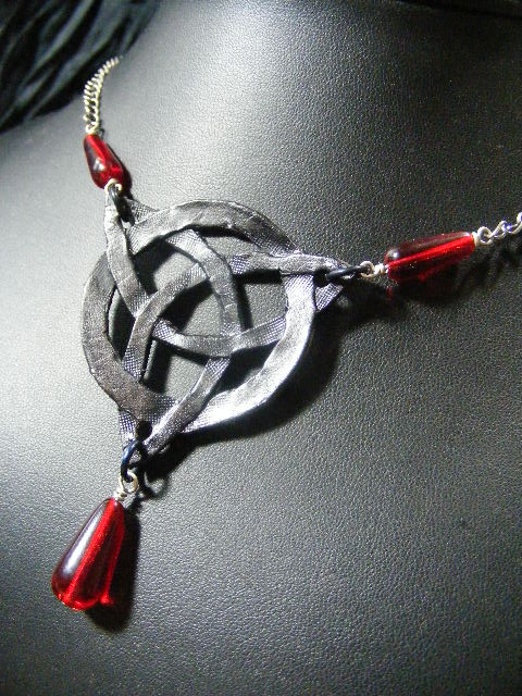 black leather triquetra with red beads