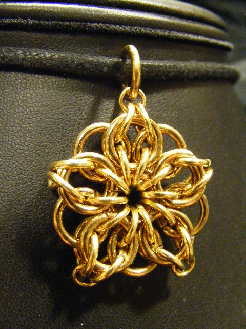 brass celtic star flower