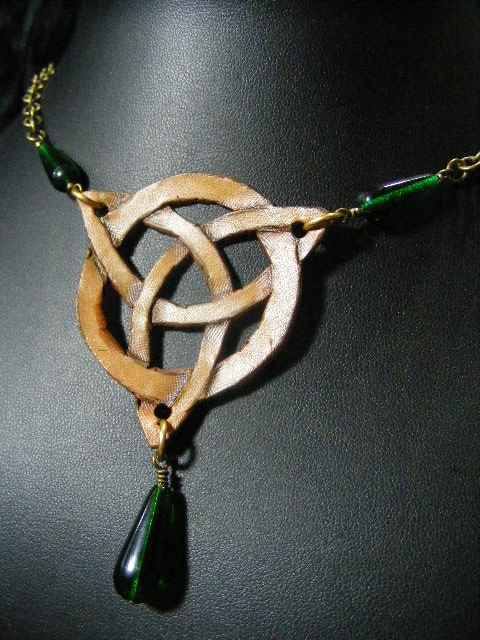 brown leather triquetra with green beads