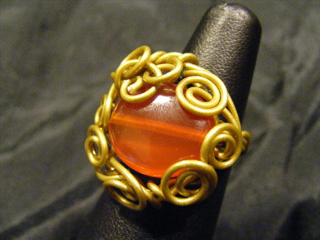 free form carnelian in brass ring