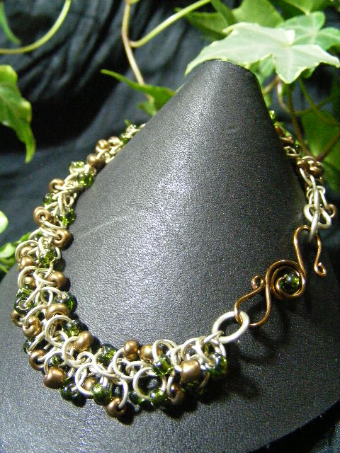 green and bronze shaggy loops with fancy clasp