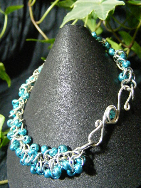 metallic blue shaggy loops bracelet with fancy clasp