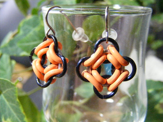 ojo de dios earrings orange