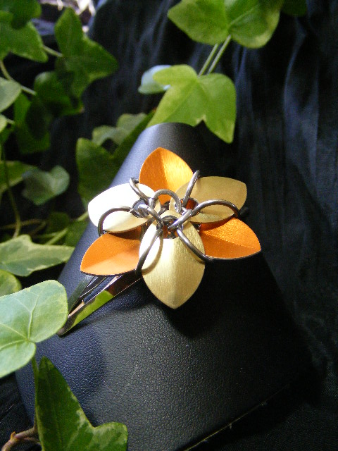 orange and gold hair flower