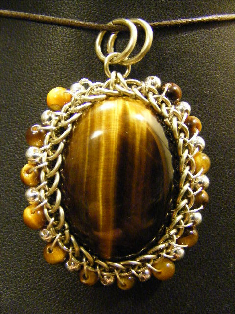 orbit tigers eye pendant