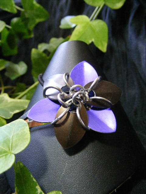 purple and black hair flower