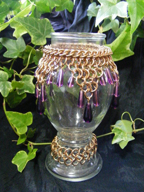 purple drops on brass maille vase
