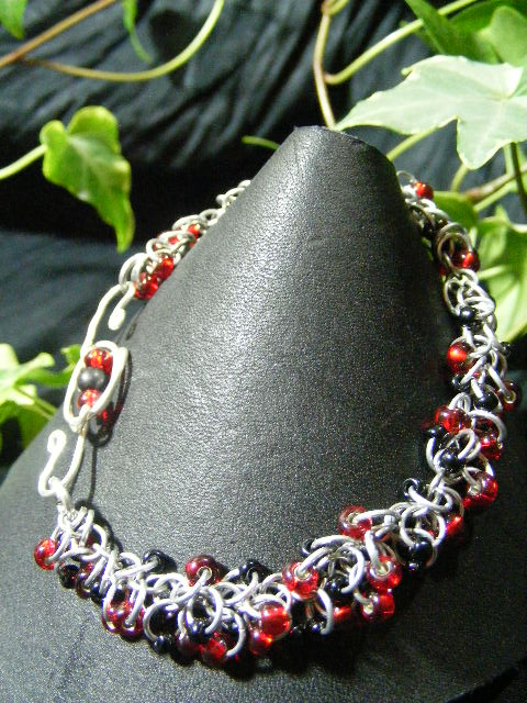 red and black shaggy loops bracelet with fancy clasp