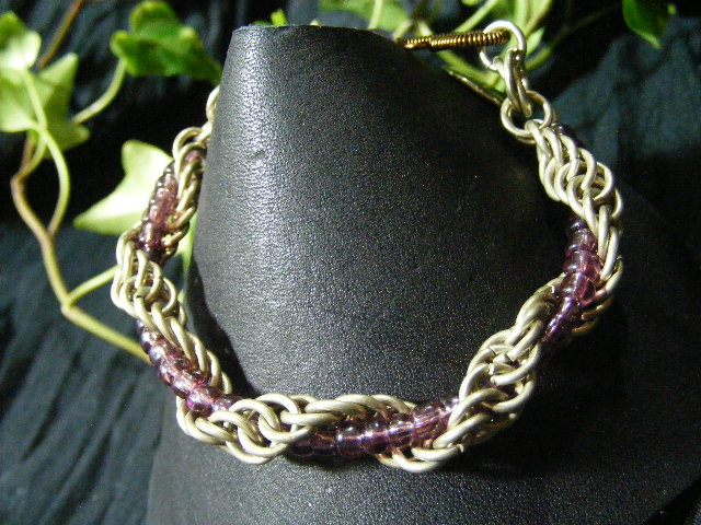 spiral bangle bracelet with purple beads and fancy clasp